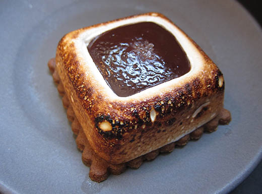 """Delicious Dandelion Chocolate S'more, chocolate square dessert with marshmallow and graham cracker, on a white plate in San Francisco, California"""""""