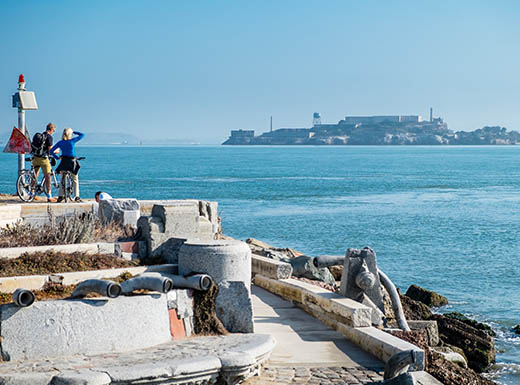 Tourists looking out over the water at Alcatraz prison, San Francisco, California