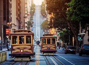 Classic view of historic traditional cable cars in San Francisco, California""