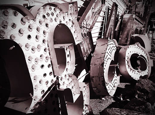 A black and white photo of parts of a neon sign from the Neon Museum in Las Vegas, Nevada
