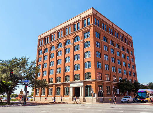 The Sixth Floor Museum in downtown Dallas, Texas on a clear, sunny day