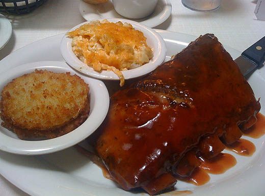 Ribs and side dishes on white plates served at Mary Mac's Tea Room in Atlanta, Georgia