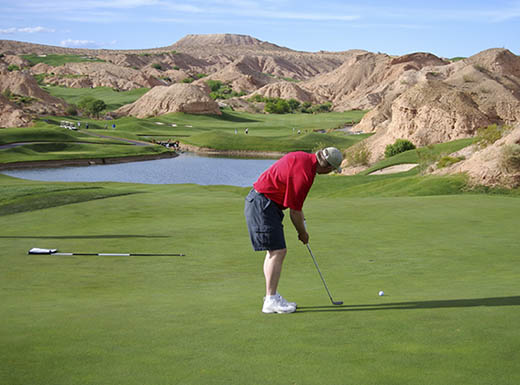 Man putting on beautiful golf course in Mesquite, Nevada