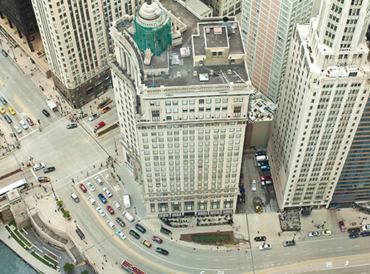 Downward view of Chicago street taken from rooftop of a building