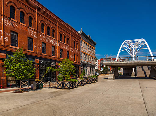A view of some historical buildings and the top of the pedestrian bridge within the Lower Highlands neighborhood of Denver, Colorado