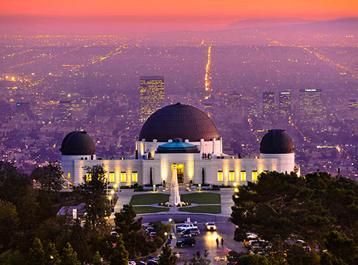 At sunset, the Observatory in L.A. overlooks the brightly lit city