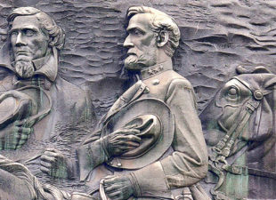 Stone carving of three men on horses at Stone Mountain Park in Atlanta