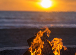 Fire on the beach at sunset in LA