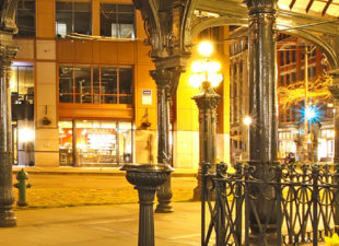 Streetlights illuminating Pioneer Square in Seattle at night