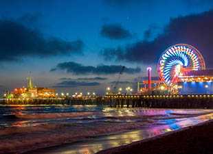The Los Angeles Ferris Wheel, a kaleidoscope of colors at night on the Santa Monica boulevard in California