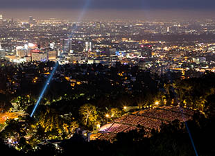 Night time view overlooking the brightly lit city of Los Angeles, CA