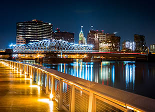 Newark, NJ, cityscape lights reflecting over water at night