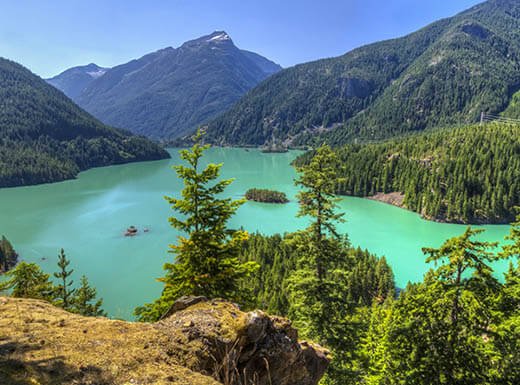 The view looking over the turquoise waters of Diablo Lake, seen from the Diablo Lake Overlook in North Cascades National Park, Washington.