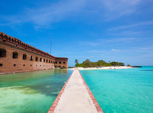 The crystal clear waters of the Gulf of Mexico surround historic Fort Jefferson in the Dry Tortugas, Florida, on a beautiful sunny day.