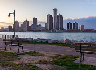 View of the Detroit River and Detroit Skyline from a bench on Belle Isle during Sunset in Michigan