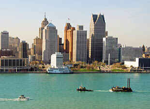 View of the Detroit, MI skyline from across the Detroit River blue sky on a clear autumn day