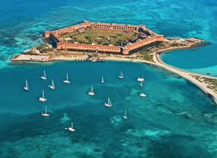 Overhead view of gorgeous blue water surrounding Fort Jefferson in Dry Tortugas National Park, Florida.