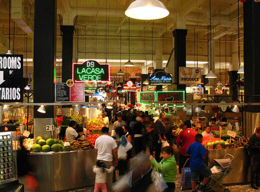 Interior showing neon signs and stands of Grand Central Market in 2007 in Los Angeles, California