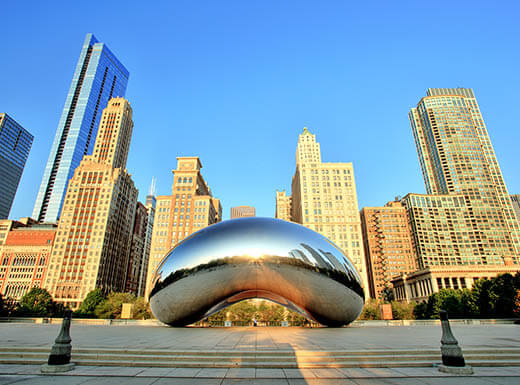Famous reflective bean at Cloud Gate in Millennium Park in Chicago during daytime