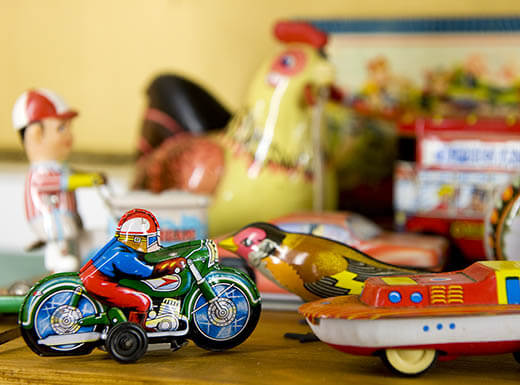 Assortment of vintage toys showcased on a table, similar to the toys found at FarWest Toys, Games & Hobbies in Seattle