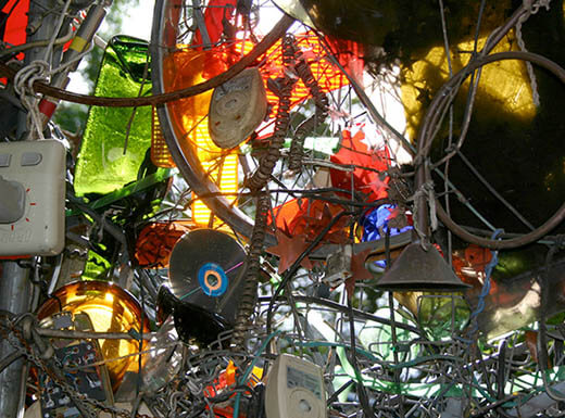 A pile of junk, including records, bicycle wheels and more, is pictured at the Cathedral of Junk in Austin, Texas