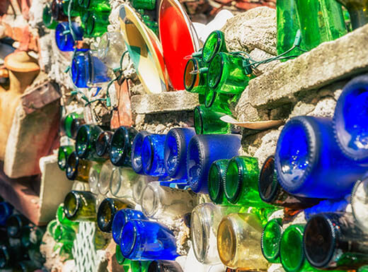 Blue, green and brown bottles – among other found objects – are a permanent installation by mosaic artist Isaiah Zagar in the Magic Garden in Philadelphia