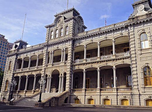 The exterior of Iolani Palace is pictured against a blue sky in Honolulu, Hawaii