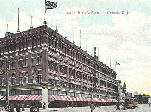 picture of Newark's Hahne  & Co  building 1908 with red awning and a flag flying at the top corner