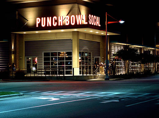 External view of Denver's Punch Bowl Social on Broadway, illuminated at night.