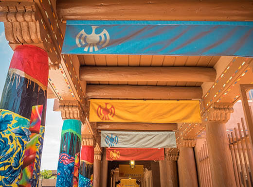 A view of a colorful, artistic walkway in the plaza in downtown Santa Fe, New Mexico on a warm morning.