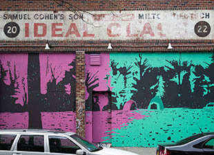 A magenta, green and black mural by Jen Hitchings shows tents pitched in front of a forest, with an old car on the side on the Ideal Glass building in New York's streets during the daytime