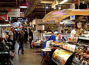 Interior view of customers and merchants at various food stalls at the Reading Terminal Market in Philadelphia