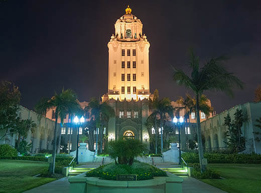 Lights illuminate Beverly Hills City Hall on a clear summer night in Los Angeles.