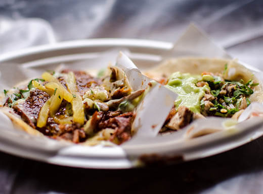 Two tacos served on a plate in New York City's Chelsea Market restaurant