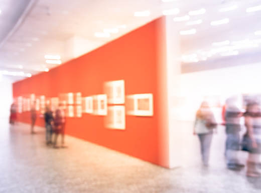 blurred image of people at an art gallery
