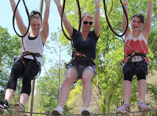 3 people having fun at Orlando Tree Trek Adventure Park