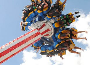 People enjoy a new ride at a Florida theme park on a sunny afternoon.