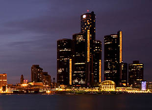 The Detroit, MI skyline, rising over the lake, at night