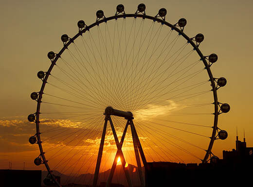 The sun rises behind the High Roller Wheel in Las Vegas.