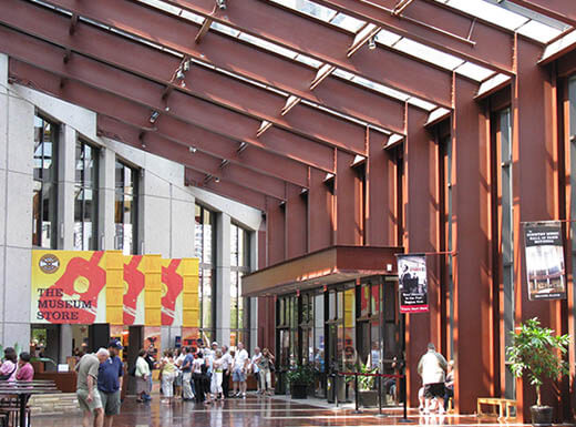 Interior view of the lobby at the Country Music Hall of Fame, with visitors in line to enter on a sunny summer day in Nashville, Tennessee