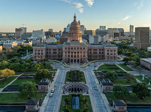 Aerial view of the Texas State Capitol building in Austin on sunny day.
