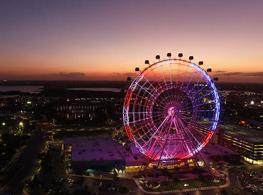 An aerial view of the Icon OrlandoTM Ferris Wheel in Orlando at dusk