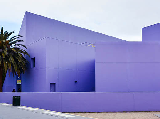 An external view of the purple Children's Discovery Museum of San Jose on an overcast morning.