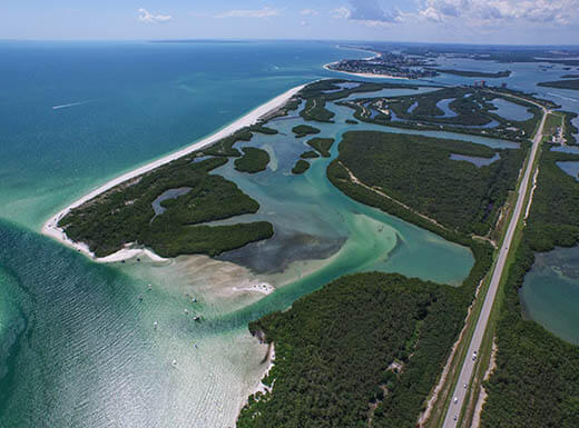 An aerial view of the Fort Myers, FL, ocean inlet on a clear afternoon