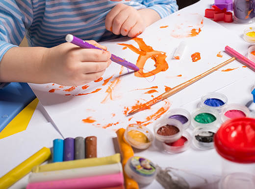 Kids painting and drawing at the Museum of Children's Arts in Oakland, California on a busy afternoon.