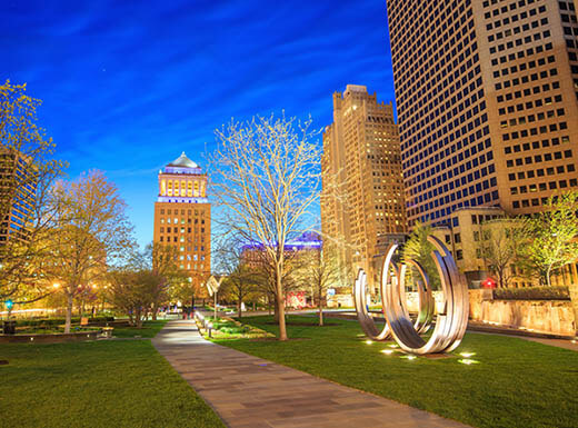 The brightly lit up public Citygarden is pictured in downtown St. Louis, Missouri on an early summer evening.