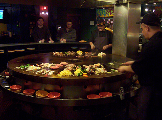 Diners create their own dishes and watch them cook on volcanic stone grills in Boston restaurant