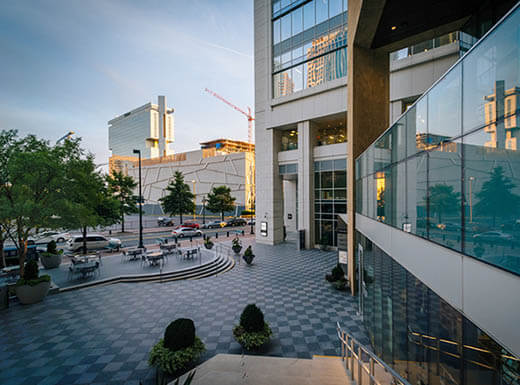 Exterior shot showing the numerous windows of the Mint Museum in uptown Charlotte, North Carolina in early evening