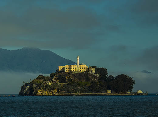 A distant view of Alcatraz at dusk on a summer evening