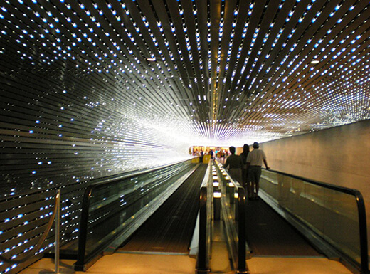 Visitors enjoying an automated walkway in the National Gallery of Art in Washington, D.C.